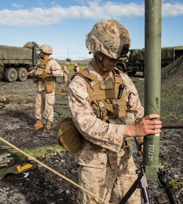 Cpl. Calvin V. Montgomery breaks down a communication antennae to move the forward command element across the battlefield March 5 during Dragon Fire Exercise 15-2 at Pohakuloa Training Area, Kona, Hawaii. The forward command element moves before the main command element to establish communication and the ability to control the fight in order for the main element to be able to move. This ensures that the command element is never without communication and can always remain in the fight. Montgomery, an Eatonton, Georgia, native, is a radio operator, with Headquarters Battery, 12th Marine Regiment, 3rd Marine Division, III Marine Expeditionary Force.