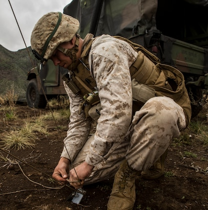 Sgt. Brandon T. Wakefield wraps cord around a stake to hold up an antennae to provide communication for the forward command element March 5 during Dragon Fire Exercise 15-2 at Pohakuloa Training Area, Kona, Hawaii. Communication is essential for the forward element to be able to command and control the regiment while the main command element moves across the battle space. Wakefield, a Shepherd, Montana, native, is a maintenance management specialist with Headquarters Battery, 12th Marine Regiment, 3rd Marine Division, III Marine Expeditionary Force.