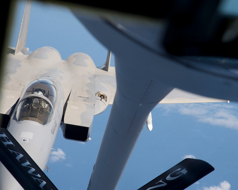 """A U.S. Air Force F-15 Strike Eagle from the 142nd Fighter Wing, Oregon Air National Guard, prepares to receive fuel during an in-air refueling  from a KC-135R Stratotanker from the 96th Air Refueling Squadron, during the Hawaii Air National Guard's exercise Sentry Aloha over Hawaii, March. 5, 2015. This is second large-scale """"Sentry Aloha"""" fighter exercise in 2015 hosting 45 aircraft and more than 1,000 servicemen from seven states. (U.S. Air Force photo by Tech. Sgt. Aaron Oelrich/Released)"""