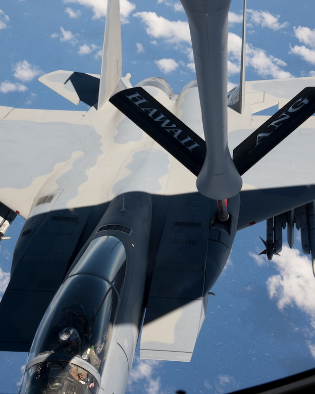 A U.S. Air Force F-15 Strike Eagle from the 142nd Fighter Wing, Oregon Air National Guard, refuels from a KC-135R Stratotanker from the 96th Air Refueling Squadron, during the Hawaii Air National Guard exercise Sentry Aloha over Hawaii, March. 5, 2015. This is second large-scale Sentry Aloha fighter exercise in 2015 hosting 45 aircraft and more than 1,000 servicemen from seven states. (U.S. Air Force photo by Tech. Sgt. Aaron Oelrich/Released)