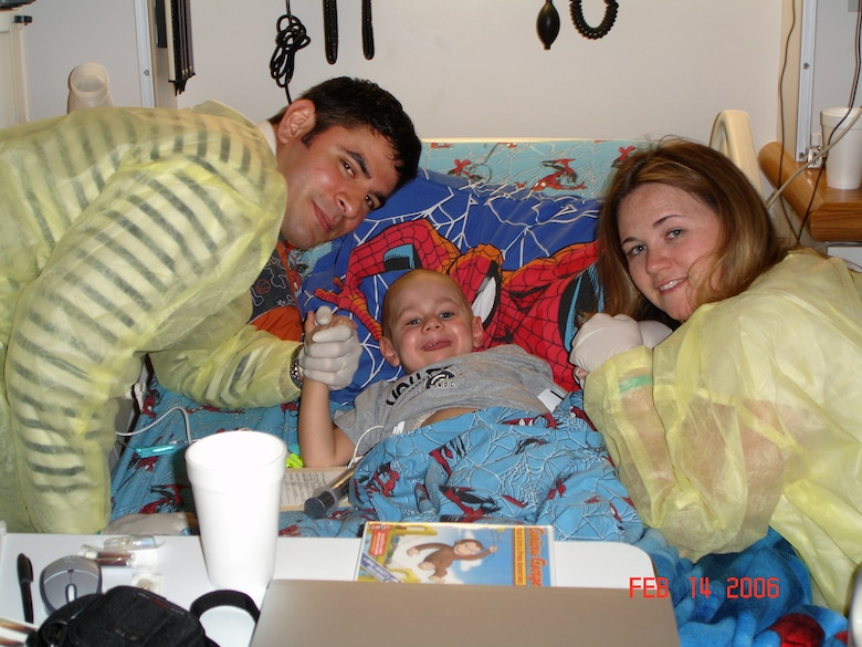 Tech. Sgt. Billy Gazzaway (left) and his wife, Master Sgt. Emily Gazzaway, take a photograph with their son, John Kadin Gazzaway, in February 2006. Kadin died of leukemia May 2, 2006. Billy is assigned to the 21st Communications Squadron at Peterson Air Force Base, Colo. And Emily is the U.S. Air Force Academy's senior enlisted aide. (Courtesy photo)