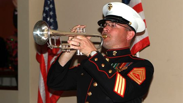 "Gunnery Sgt. Michael Flaningam, a trumpet player in the 1st Marine Division Band, I Marine Expeditionary Force, plays taps in memory of fallen Marines during the Iwo Jima Commemorative Banquet for the 70th Anniversary of the Battle of Iwo Jima at Marine Corps Base Camp Pendleton, Calif., March 7. The evening included a sunset memorial, 21-gun salute, banquet and a video message for veterans from Commandant of the Marine Corps General Joseph Dunford. ""Your legacy is the young men and women who use your example of courage and commitment to inspire them to confront and overcome the challenges that they face today … I pledge that today's Marines will keep the spirit of Iwo Jima alive,"" said Dunford."