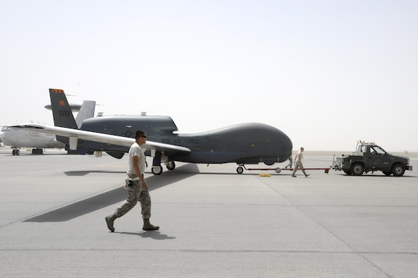 Airmen from an RQ-4B Global Hawk aircraft maintenance unit welcome an RQ-4B after a flight Mar. 8, 2015, in Southwest Asia, in which the aircraft surpassed 10,000 flying hours. The RQ-4B aircraft 2019, or A2019, was the first block 20 and first RQ-4B model to arrive here Oct. 16, 2010. During its service, the aircraft has been providing support to warfighters by relaying communications between people and aircraft as well as enabling airstrikes on the Islamic State of Iraq and the Levant. (U.S. Air Force photo/Tech. Sgt. Marie Brown)