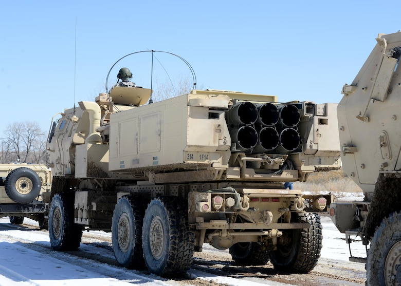 Soldiers form a line to transport their M142 High Mobility Artillery Rocket System vehicles after successfully firing 12 rockets, March 6, 2015, at Fort Carson, Colo. The training helped Airmen and Soldiers stay proficient in transporting, setting up and firing a HIMARS. The Soldiers were from the 1st Battalion, 14 Field Artillery Regiment, 214th Fires Brigade. (U.S. Air Force photo/Airman 1st Class Nathan Clark)