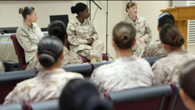Women Marines assigned to Special Purpose Marine Air Ground Task Force – Crisis Response – Central Command, listen to advice from senior leaders during the Women Marine Symposium leadership panel, March 2, 2015, in the Central Command area of operations. The symposium was organized to inform the participants about upcoming changes for women Marines, to share the rich history of women in the Corps and to encourage leadership and esprit de corps.
