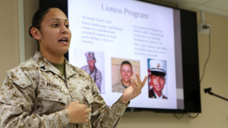 U.S. Marine Corporal Ilene Munoz, meteorological oceanographic analyst forecaster, Special Purpose Marine Air Ground Task Force – Crisis Response – Central Command, informs Women Marine Symposium participants of the changes in store for women in the Marine Corps, such as the role of women in combat, March 2, 2015, in the Central Command area of operations. The symposium was organized to inform the participants about upcoming changes for women Marines, to share the rich history of women in the Corps and to encourage leadership and esprit de corps.