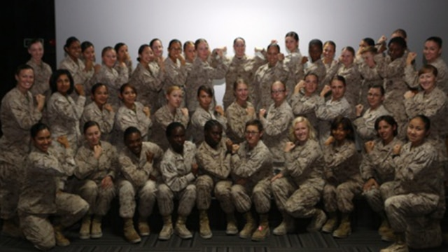 Women Marines assigned to Special Purpose Marine Air Ground Task Force – Crisis Response – Central Command pose for a picture after the Women Marine Symposium, March 2, 2015, in the Central Command area of operations. The symposium was organized to inform the participants about upcoming changes for women Marines, to share the rich history of women in the Corps and to encourage leadership and esprit de corps.