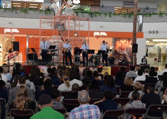 The Air Force Band of the Pacific's Papana, from Joint Base Pearl Harbor Hickam, HI, plays music for the band children of Department of Defense Education Activity schools Mar. 10, 2015, at Micronesia Mall in Dededo, Guam. The Air Force Band of the Pacific's Papana supports the U.S. Pacific command strategies of partnership, readiness and presence by conducting protocol, community and nation-building missions throughout the pacific. (U.S. Air Force photo by Senior Airman Cierra Presentado/Released)