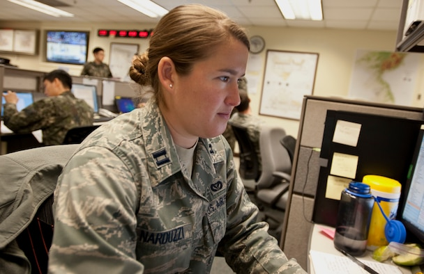 U.S. Air Force Capt. Anna Narduzzi, the Seventh Air Force plans and readiness chief, reviews emails March 10, 2015, during exercise Key Resolve on Osan Air Base. Training exercises like Key Resolve highlight the longstanding partnership and enduring friendship between United Nations Command Sending States' assurance to peace and security on the Peninsula, and reaffirms the U.S. commitment to the region. (U.S. Air Force photo by William Banton)
