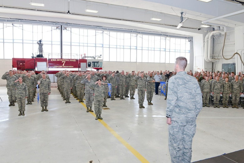 Members of the 132d Wing (132WG), Des Moines, Iowa Intelligence Surveillance Reconnaissance Group (ISRG) (back, saluting) give their first salute to Col. Mark Chidley (front right), 132WG ISRG Commander, during the 132WG ISRG Activation Ceremony held in the 132WG Fire House on Saturday, March 7, 2015.  This ceremony formally recognizes the official activation of the 132WG ISRG.  (U.S. Air National Guard photo by Senior Airman Michael J. Kelly/Released)