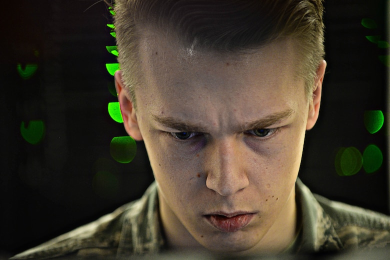 Airman 1st Class Brandon Koch, 28th Communications Squadron cyber systems operator, troubleshoots a server network at Ellsworth Air Force Base, S.D., March 3, 2015. The base network consists of more than 50 servers providing support to base personnel. (U.S. Air Force photo by Airman 1st Class Zachary Hada/Released)