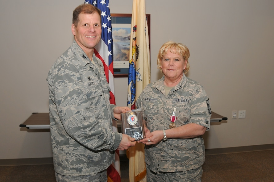 U.S. Air Force Master Sgt. Dreama Heath, right, receives both a Meritorious Service Medal and the 2014 177th Fighter Wing Leadership Award from Col. Kerry M. Gentry, 177th Fighter Wing commander, during a ceremony on Feb. 8, 2015. (U.S. Air National Guard photo by Airman 1st Class Amber Powell/Released)