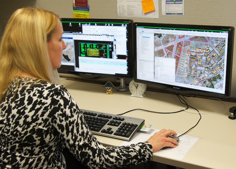 Freda Kuhl, with the 96th Civil Engineer Group's Engineering Division, demonstrates the division's geographic information system at Eglin Air Force Base, Fla. The GIS division is responsible for keeping facility and infrastructure features used for map production up to date. These maps are used for community planning, special events, contingency planning and more. There are over 400 features in the Eglin Enterprise Spatial Database that must be maintained and updated. (U.S. Air Force photo/Ilka Cole)
