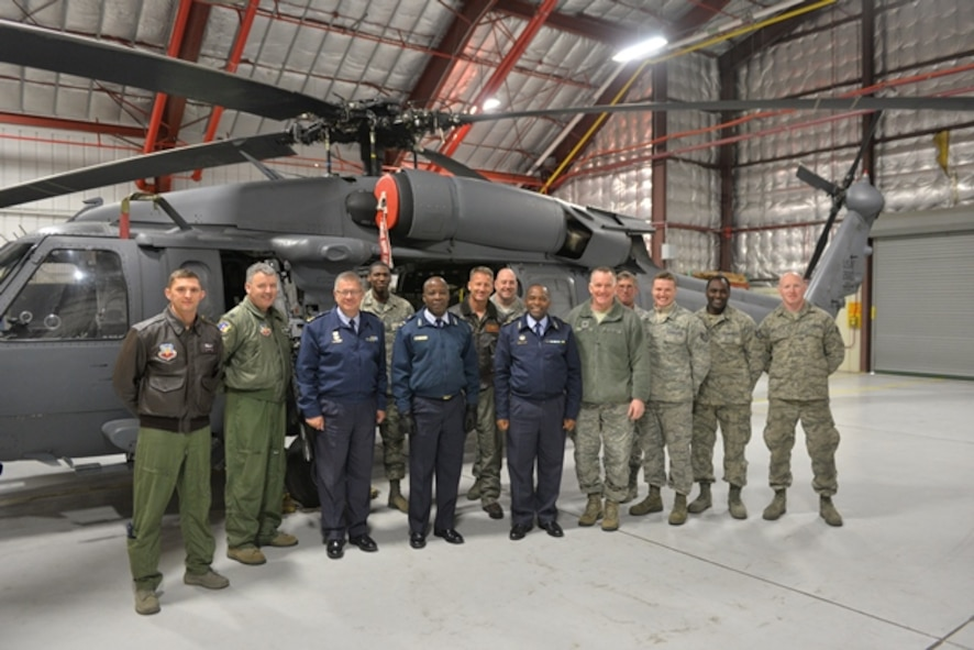 WESTHAMPTON BEACH, NY- Members of the South African National Defence Forces, 106th Rescue Wing commader and members pose with the 106th Rescue Wing's HH-60 Pavehawk helicopter.  Maj. Gen. Mbambo and Brig. Gen. Mashoro Phala visited the 106th Rescue Wing in Westhampton Beach, New York, as part of the South African Natioanl Defence Force's State Partnership Program relationship with the New York Natioanal Guard.  (New York Air National Guard/ Airman 1st Class Mark Weiss/ released)