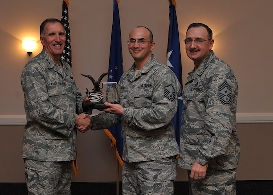 The 2014 Eighth Air Force Noncommissioned Officer of the Year - Tech. Sgt. Nathan Parker, 608th Air Operations Center. Accepting on his behalf, Master Sgt. Wally Lozano. (U.S. Air Force photo/Senior Airman Joseph Raatz)