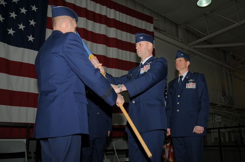 Col. John R. DiDonna, Jr., center, accepts command of the 177th Fighter Wing from Brig. Gen. Robert C. Bolton, left, commander of the New Jersey Air National Guard, during a change of command ceremony March 8, 2015 at Atlantic City Air National Guard Base, N.J. (U.S. Air National Guard photo by Airman 1st Class Amber Powell/Released)