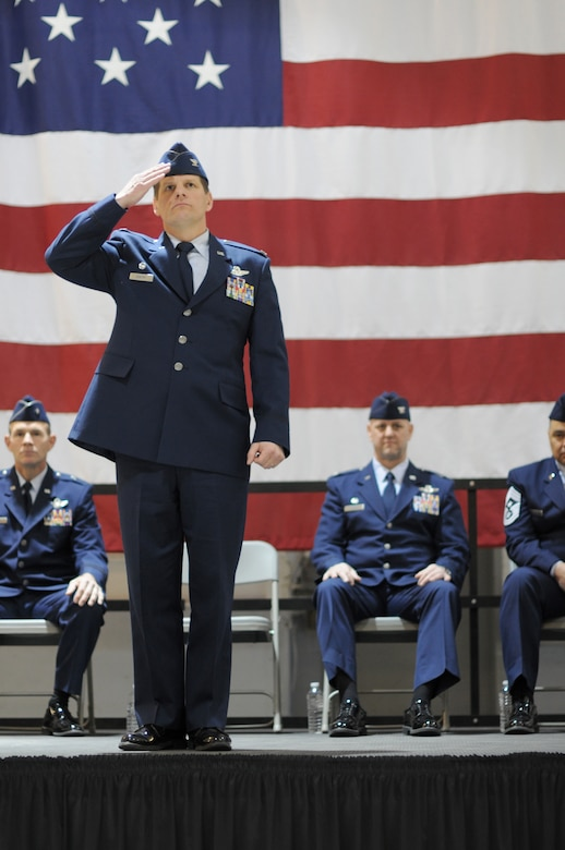 Col. Kerry M. Gentry, former 177th Fighter Wing commander, salutes his Airmen for one last time as commander after a change of command ceremony March 8, 2015 at Atlantic City Air National Guard Base, N.J.  Col. John R. DiDonna, Jr., former 177th Fighter Wing vice commander, took over as the new wing commander. (U.S. Air National Guard photo by Senior Airman Shane S. Karp/Released)