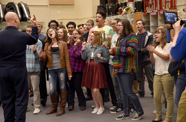 "Skyline High School students sing Journey's, ""Don't Stop Believin',"" with Senior Master Sgt. Ryan Carson, U.S. Air Force Band Max Impact vocalist, during an educational outreach program in Mesa, Ariz., Jan. 30, 2015. Max Impact mentored, advised and educated students during an Advancing Innovation through Music clinic. (U.S. Air Force photo/ Senior Airman Nesha Humes)"