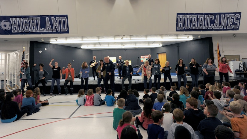 Highland Elementary School teachers dance for their students during a U.S. Air Force Band Max Impact performance in Mesa, Ariz., Jan. 30, 2015. Max Impact taught students about U.S. Air Force values in addition to a performance during an Advancing Innovation through Music clinic. (U.S. Air Force photo/ Senior Airman Nesha Humes)