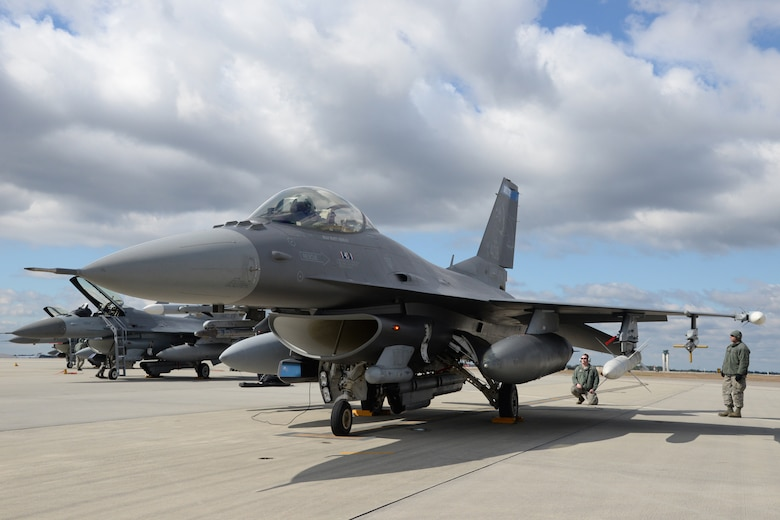 A crew chief, 148th Fighter Wing, Duluth, Minn. prepares a Block 50, F-16 for take-off during a Sentry Savannah training exercise, Feb 10, 2015, Savannah, Ga.  The Sentry Savannah training exercise allows fighter pilots to participate in war simulations that depict what they would face in a real world scenario.  (U.S. Air National Guard photo by Master Sgt. Ralph Kapustka/Released)