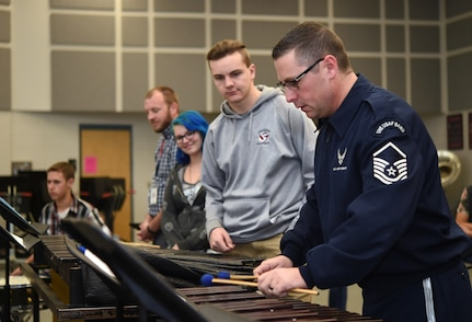 Master Sgt. Tom Rarick, U.S. Air Force Band Ceremonial Brass percussionist, demonstrates an instrument technique on the xylophone to students at McClintock High School in Tempe, Ariz., Jan. 27, 2015. In between country-wide performances, Band members hold Advanced Innovation through Music clinics to advise, mentor and educate students on music. (U.S. Air Force photo/ Senior Airman Nesha Humes)