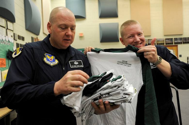 Tech Sgt. Robert K. Smith, U.S. Air Force Band Max Impact percussionist and Jonathan McPherson, USAF Band Max Impact pianist, looks at T-shirts at Skyline High School in Mesa, Ariz., Jan 30, 2015. The high school music class gave the rock stars Skyline band shirts to thank them for their Advancing Innovation through Music workshop. (U.S. Air Force photo/ Senior Airman Nesha Humes)