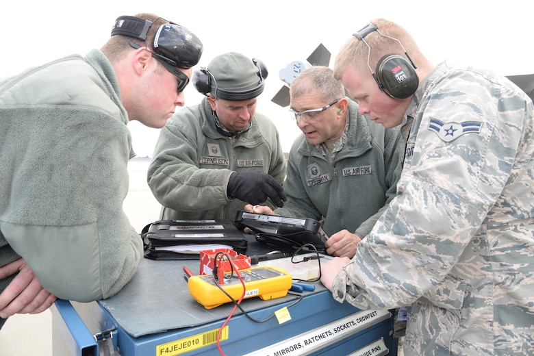 Senior Airman Rick Petcoff, Master Sgt. Rick Cornelison, Master Sgt. Wayne Gressman and Airman 1st Class Tanner Beckwith, 148th Fighter Wing, Duluth, Minn. work on a Block 50 F-16  during a Sentry Savannah training exercise, Feb 10, 2015, Savannah, Ga.  The Sentry Savannah training exercise allows fighter pilots to participate in war simulations that depict what they would face in a real world scenario.  (U.S. Air National Guard photo by Master Sgt. Ralph Kapustka/Released)
