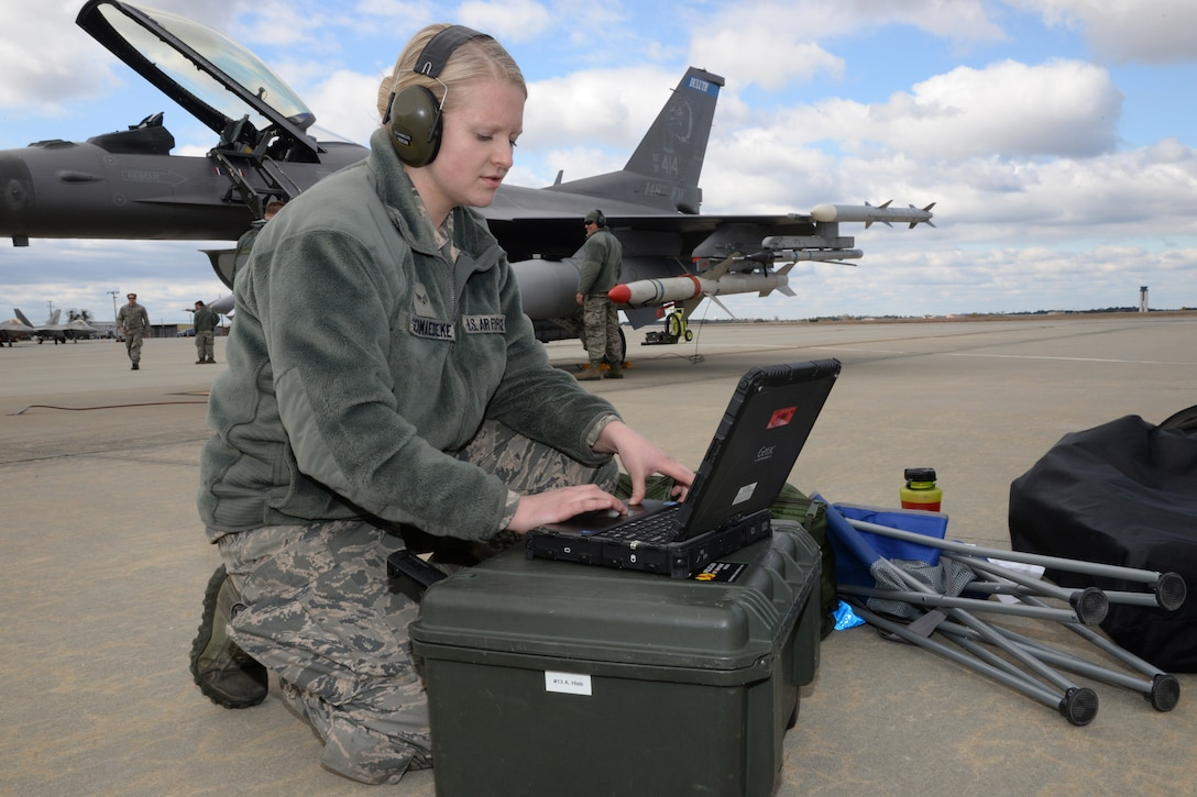 Senior Airman Jessalyn Schmaedeke, 148th Fighter Wing, Duluth, Minn. works on a Block 50 F-16  during a Sentry Savannah training exercise, Feb 10, 2015, Savannah, Ga.  The Sentry Savannah training exercise allows fighter pilots to participate in war simulations that depict what they would face in a real world scenario.  (U.S. Air National Guard photo by Master Sgt. Ralph Kapustka/Released)