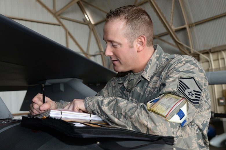 Master Sgt. Adam Hieb, 148th Fighter Wing, Duluth, Minn. documents data on a Block 50 F-16  during a Sentry Savannah training exercise, Feb 9, 2015, Savannah, Ga.  The Sentry Savannah training exercise allows fighter pilots to participate in war simulations that depict what they would face in a real world scenario.  (U.S. Air National Guard photo by Master Sgt. Ralph Kapustka/Released)