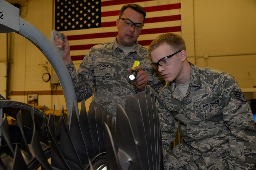 Senior Airman William Lacine and Staff Sgt. Matthew McEwen, 148th Fighter Wing Engine Shop inspect second stage fan blades on an F-16 engine, March 7, 2015, Duluth, Minn.  These routine inspections are in place to catch problems when they are small and fix them before they blossom into much bigger problems.  (U.S. Air National Guard photo by Master Sgt. Ralph J. Kapustka/Released)