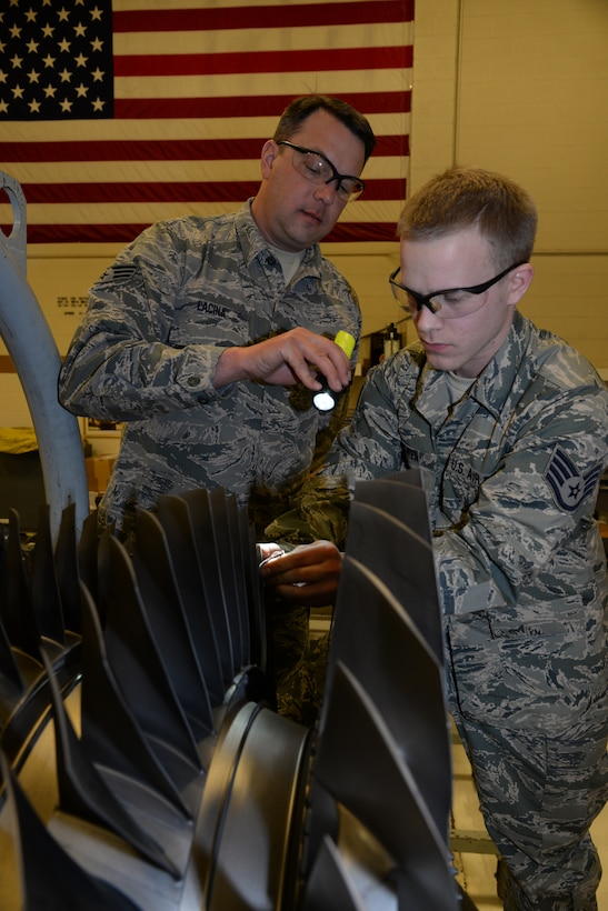 Senior Airman William Lacine and Staff Sgt. Matthew McEwen, 148th Fighter Wing Engine Shop blend second stage fan blades on an F-16 engine, March 7, 2015, Duluth, Minn.  These routine inspections are in place to catch problems when they are small and fix them before they blossom into much bigger problems.  (U.S. Air National Guard photo by Master Sgt. Ralph J. Kapustka/Released)