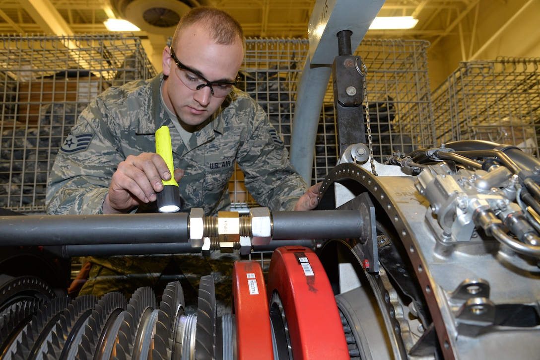 Staff Sgt. Steven Lind, 148th Fighter Wing Engine Shop inspects the compressor rotor on an F-16 engine, March 7, 2015, Duluth, Minn.  These routine inspections are in place to catch problems when they are small and fix them before they blossom into much bigger problems.  (U.S. Air National Guard photo by Master Sgt. Ralph J. Kapustka/Released)