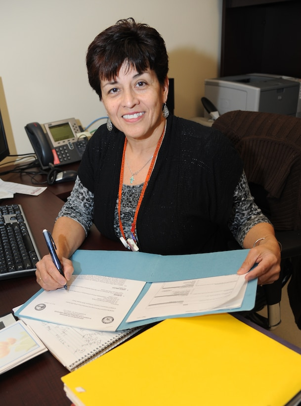 Martha Prieto-Moreno, 81st Medical Group patient advocate, reviews a patient's recommendation for improvements March 9, 2015, at Keesler Medical Center, Keesler Air Force Base, Miss. Patients can provide feedback by using the Interactive Customer Evaluation web-based tool by logging on to http://www.keesler.af.mil/units/81stmedicalgroup.asp and click on the ICE icon at the bottom left-hand corner, or they can access http://ice.disa.mil and follow the prompts.  (U.S. Air Force photo by Kemberly Groue)