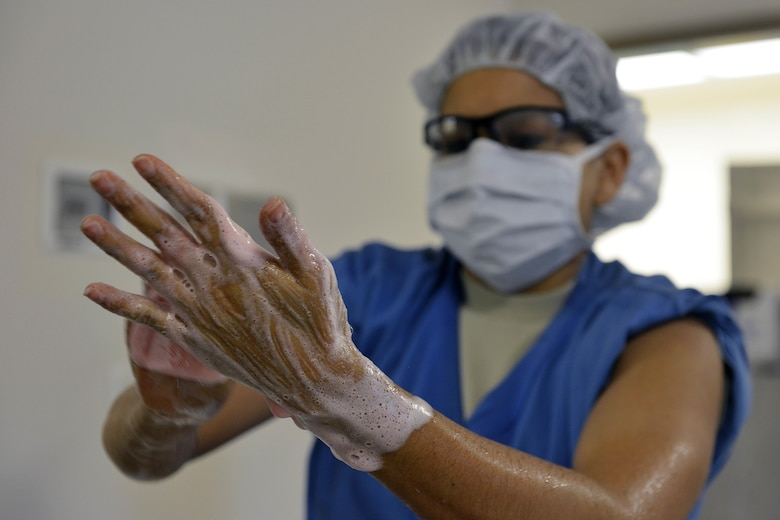 Senior Airman Sylvia Coon scrubs her hands before assisting with a surgery March 4, 2015, at Aviano Air Base, Italy. Surgical technicians are enlisted Service members responsible for supporting the surgeon and sterilizing and maintaining medical instruments. Coon is a 31st Surgical Operations Squadron surgical technician. (U.S. Air Force photo/Airman 1st Class Ryan Conroy)