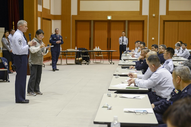 U.S. forces, Japan and Chief Master Sgt. James Laurent briefs during an annual resiliency training course March 3, 2015, at the Ministry of Defense in Ichigaya, Japan. The Yokota Air Base resiliency team shared skills to improve communication between Japan Self-Defense Force leadership and their junior enlisted. Laurent is the 5th Air Force command chief. (U.S. Air Force photo/Airman 1st Class David C. Danford)