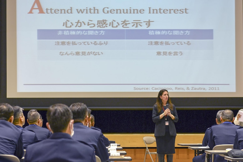 Micaela Alexander briefs Japan Self-Defense Forces members on 'good listening' practices March 3, 2015, at the Ministry of Defense in Ichigaya, Japan. Yokota Air Base's resiliency team shared their skills with JSDF members as part of an annual seminar. Alexander is a 374th Airlift Wing community support coordinator. (U.S. Air Force photo/Airman 1st Class David C. Danford)