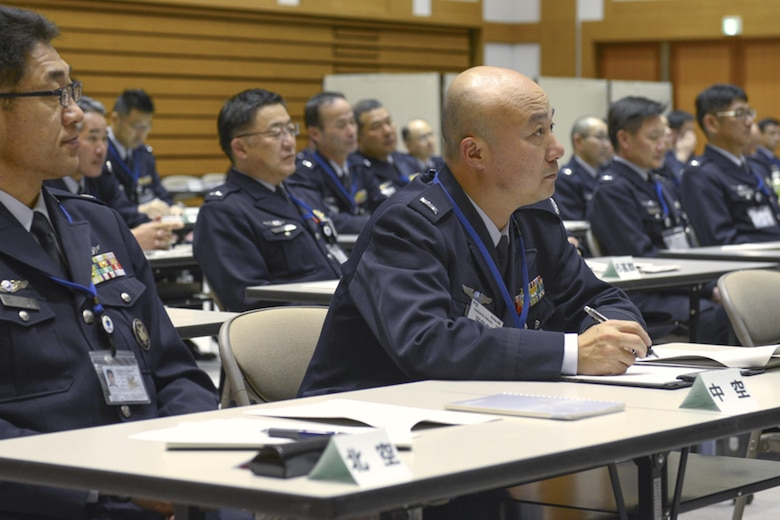 Senior enlisted members from the Japan Air Self-Defense Force listen as Yokota Air Base's resiliency team share skills to improve communication between JSDF leadership and their junior enlisted March 3, 2015, at the Ministry of Defense in Ichigaya, Japan. Two techniques were taught by the team during the seminar. (U.S. Air Force photo/Airman 1st Class David C. Danford)