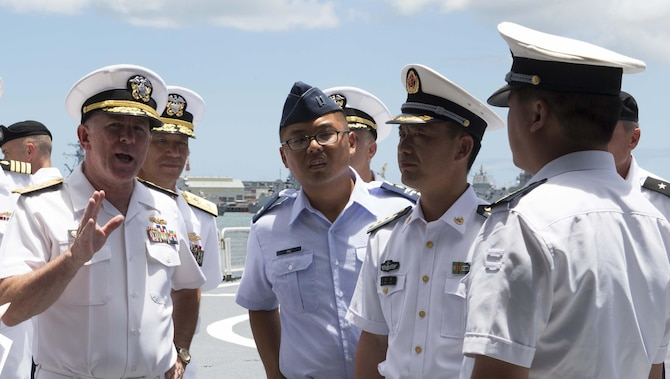 Capt. Joshua Hu (center) assists officials during their visit to the People's Liberated Army navy hospital ship, the ARK PEACE, by the U.S. Pacific Command surgeon general and staff during Rim of the Pacific 2014. This was the first time Chinese ships participated in RIMPAC, the largest maritime exercise in the world. (Courtesy photo)