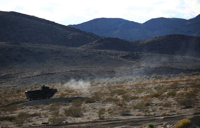 Marines with Amphibious Assault Vehicle Platoon, Company B, Ground Combat Element Integrated Task Force, assault targets down range during the assessment at Range 500, Marine Corps Air Ground Combat Center Twentynine Palms, California, March 3, 2015. From October 2014 to July 2015, the GCEITF will conduct individual and collective level skills training in designated ground combat arms occupational specialties in order to facilitate the standards-based assessment of the physical performance of Marines in a simulated operating environment performing specific ground combat arms tasks. (U.S. Marine Corps photo by Cpl. Paul S. Martinez/Released)