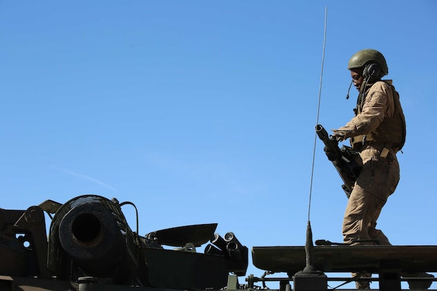 Sgt. Zarina I. Flemming, crew chief, Amphibious Assault Vehicle Platoon, Company B, Ground Combat Element Integrated Task Force, prepares to mount a mark 19 40mm automatic grenade launcher atop an AAV during the assessment at Range 500, Marine Corps Air Ground Combat Center Twentynine Palms, California, March 5, 2015. From October 2014 to July 2015, the GCEITF will conduct individual and collective level skills training in designated ground combat arms occupational specialties in order to facilitate the standards-based assessment of the physical performance of Marines in a simulated operating environment performing specific ground combat arms tasks. (U.S. Marine Corps photo by Cpl. Paul S. Martinez/Released)