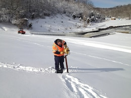 Maintenance Mechanic Keith Chaney conducts a safety inspection of the W.H. Harsha Dam on March 6, 2015. Reading the piezometers is necessary after heavy rain and snowfall.