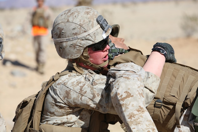 Cpl. Katie M. Gorz, team leader with 2nd Platoon, Company A, Ground Combat Element Integrated Task Force, conducts a fire-team assisted carry during a simulated casualty evacuation portion of a Marine Corps Operational Test and Evaluation Activity assessment at Range 107, Marine Corps Air Ground Combat Center Twentynine Palms, March 9, 2015. From October 2014 to July 2015, the GCEITF will conduct individual and collective level skills training in designated ground combat arms occupational specialties in order to facilitate the standards-based assessment of the physical performance of Marines in a simulated operating environment performing specific ground combat arms tasks. (U.S. Marine Corps photo by Sgt. Alicia R. Leaders/Released)