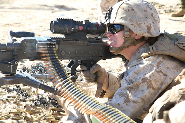 Sgt. Hannah S. Jacobson, machine gunner with Weapons Company, Ground Combat Element Integrated Task Force, provides close supporting fires for her squad while engaging targets with the M240B Medium Machine Gun during a Marine Corps Operational Test and Evaluation Activity assessment at Range 107, Marine Corps Air Ground Combat Center Twentynine Palms, March 10, 2015. From October 2014 to July 2015, the GCEITF will conduct individual and collective level skills training in designated ground combat arms occupational specialties in order to facilitate the standards-based assessment of the physical performance of Marines in a simulated operating environment performing specific ground combat arms tasks. (U.S. Marine Corps photo by Sgt. Alicia R. Leaders/Released)