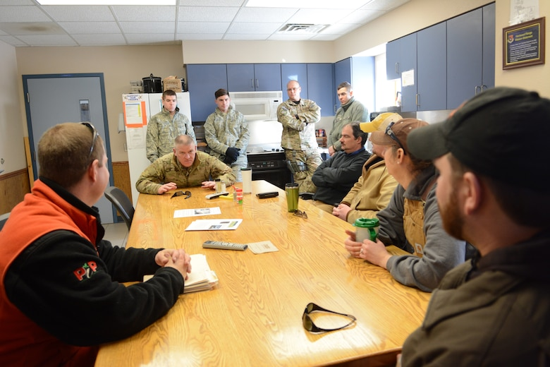 Senior Master Sgt. Ed Smith, 115th Fighter Wing Explosive Ordnance Disposal superintendent, briefs people from the Juneau County Forestry Department and the Department of Natural Resources prior to an EOD training exercise in Finley, Wis., March 6, 2015. The EOD team cleared a waterway for the Juneau County Forestry Department using various explosives. (U.S. Air National Guard photo by Senior Airman Andrea F. Rhode)