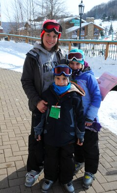 Meg Calero,  914th Force Support Squadron, Airman and Family Readiness coordinator, poses for a picture with her children at Holiday Valley Ski Resort in Ellicottville, New York on Feb 16, 2015. Calero was participating in a 914th Airlift Wing sponsored event. (U.S. Air Force photo by Staff Sgt. Matthew Burke)