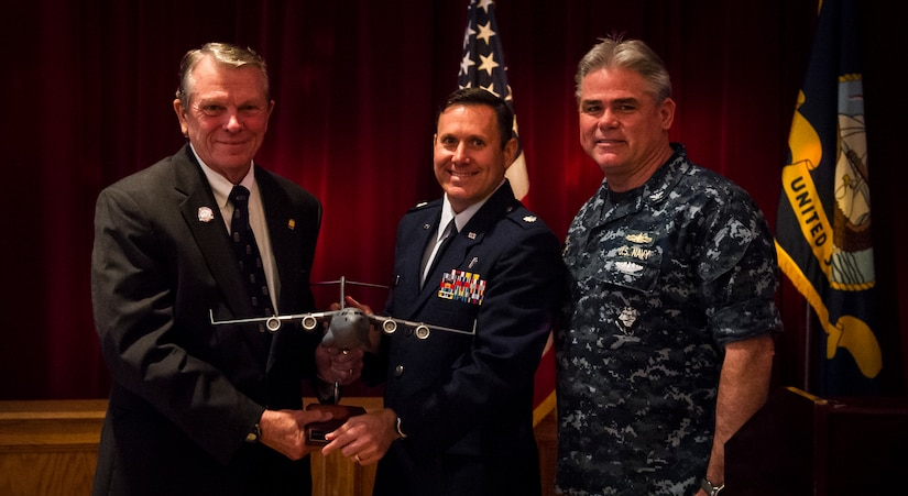 Navy Capt. Timothy Sparks, Joint Base Charleston deputy commander and Air Force Chaplain (Lt. Col.) Daniel Thompson, 628th Air Base Wing joint base senior chaplain present a gift of appreciation to Dr. Jairy Hunter Jr., president and professor of management at Charleston Southern University March 11, 2015, during the 2015 National Prayer Breakfast held at the Red Bank Club on Joint Base Charleston – Weapons Station. The National Prayer Breakfast is a yearly event that is primarily held in Washington, D.C., on the first Thursday in February. The event, which actually consisted of luncheons, meetings and dinners, has taken place since 1953 and has been held at least since the 1980's in Washington, D.C. (U.S. Air Force photo/Airman 1st Class Clayton Cupit)