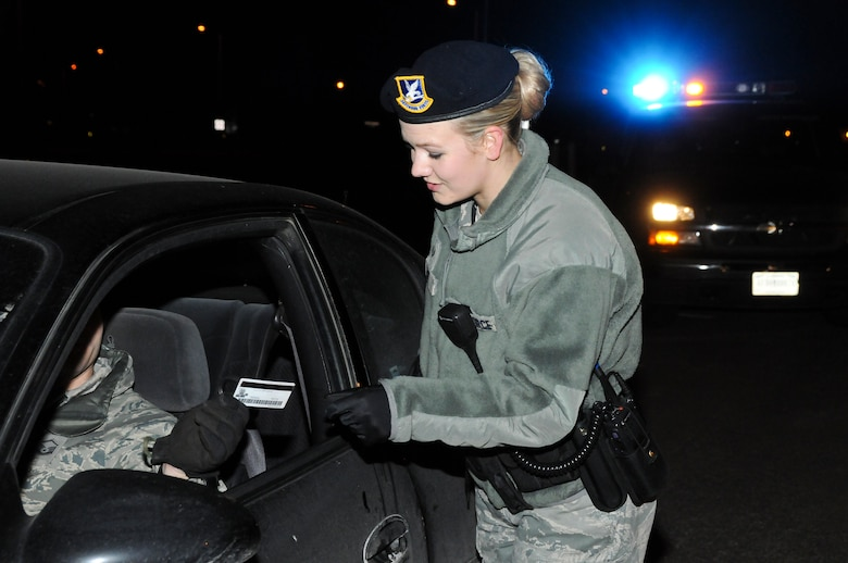 Senior Airman Jorrie Hart, 114th Security Forces Squadron installation controller, practices a routine traffic stop during an exercise while on shift at Joe Foss Field, S.D., Feb. 24, 2015. The SFS conducts regular training scenarios to maintain proficiency and enable mission success.(National Guard photo by Staff Sgt. Luke Olson/Released)