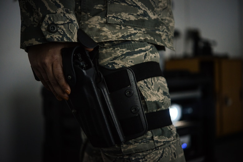 An Airman assigned to the 86th Security Forces Squadron grips her air compressed weapon before a use of force training exercise. Defenders arriving at Ramstein must complete this annual training in order to stay armed. The training course is comprised of three components which include a classroom portion, a written exam and a virtual test on the firearms training system. (U.S. Air Force photo/Senior Airman Nicole Sikorski)