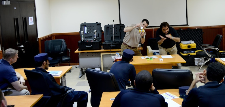 U.S. Special Agent Chad Hutchins, Forensics Science Consultant from the Federal Law Enforcement Training Center in Brunswick, Ga., demonstrates how he dusts for fingerprints on a can during a liaison exchange, March 3, 2015, at the Criminal Evidence and Information Department, Ar-Rayyan, Qatar. During the liaison exchange, members from Air Force Office of Special Investigations Detachment 241 and their Qatari counterparts shared different forensic methods they use when investigating a crime scene. (U.S. Air Force photo by Senior Airman Kia Atkins)