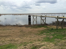 Technical visit in Savannah Harbor: A weir, used to control the water levels inside the dredge material disposal area.